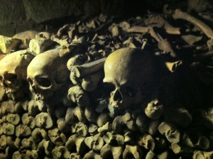 Skulls and bones are stacked creatively in the Parisian Catacombs. Photo credit: V. Laino