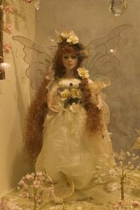 Fairy doll near a wall