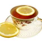 A cup of tea and slices of lemon