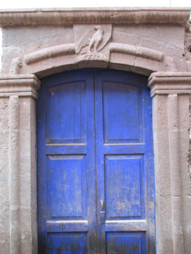 A condor, the messenger to the gods, over a door in Pisac, Peru Photo credit: M. Ciavardini