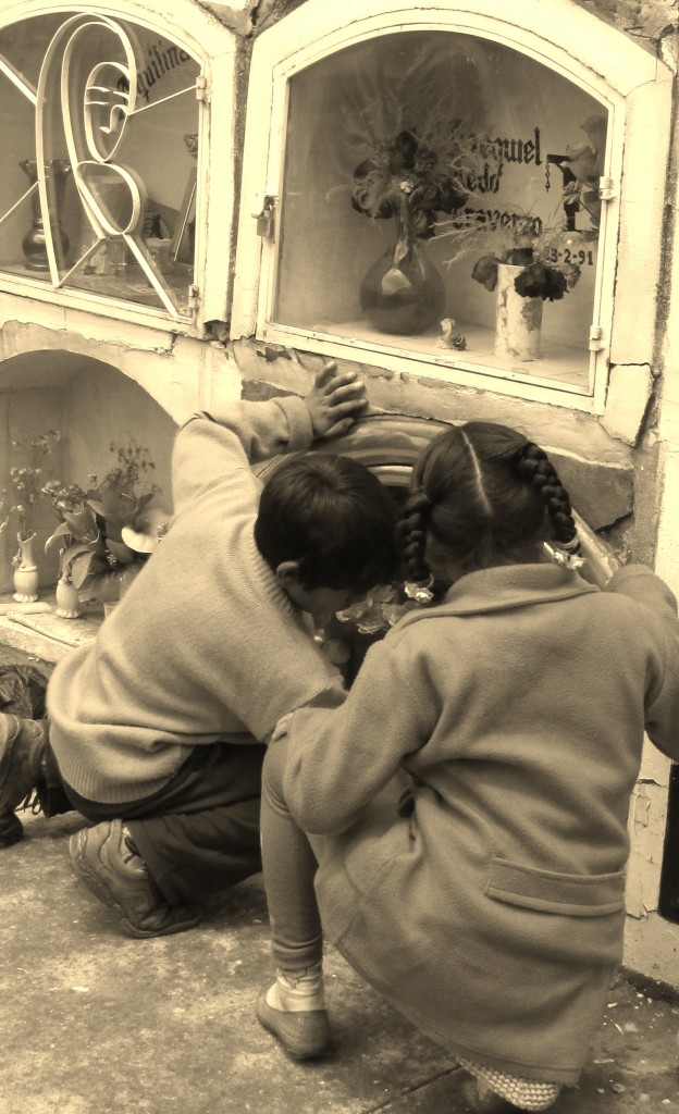 Two young grave cleaners in Cusco, Peru Photo credit: M. Ciavardini