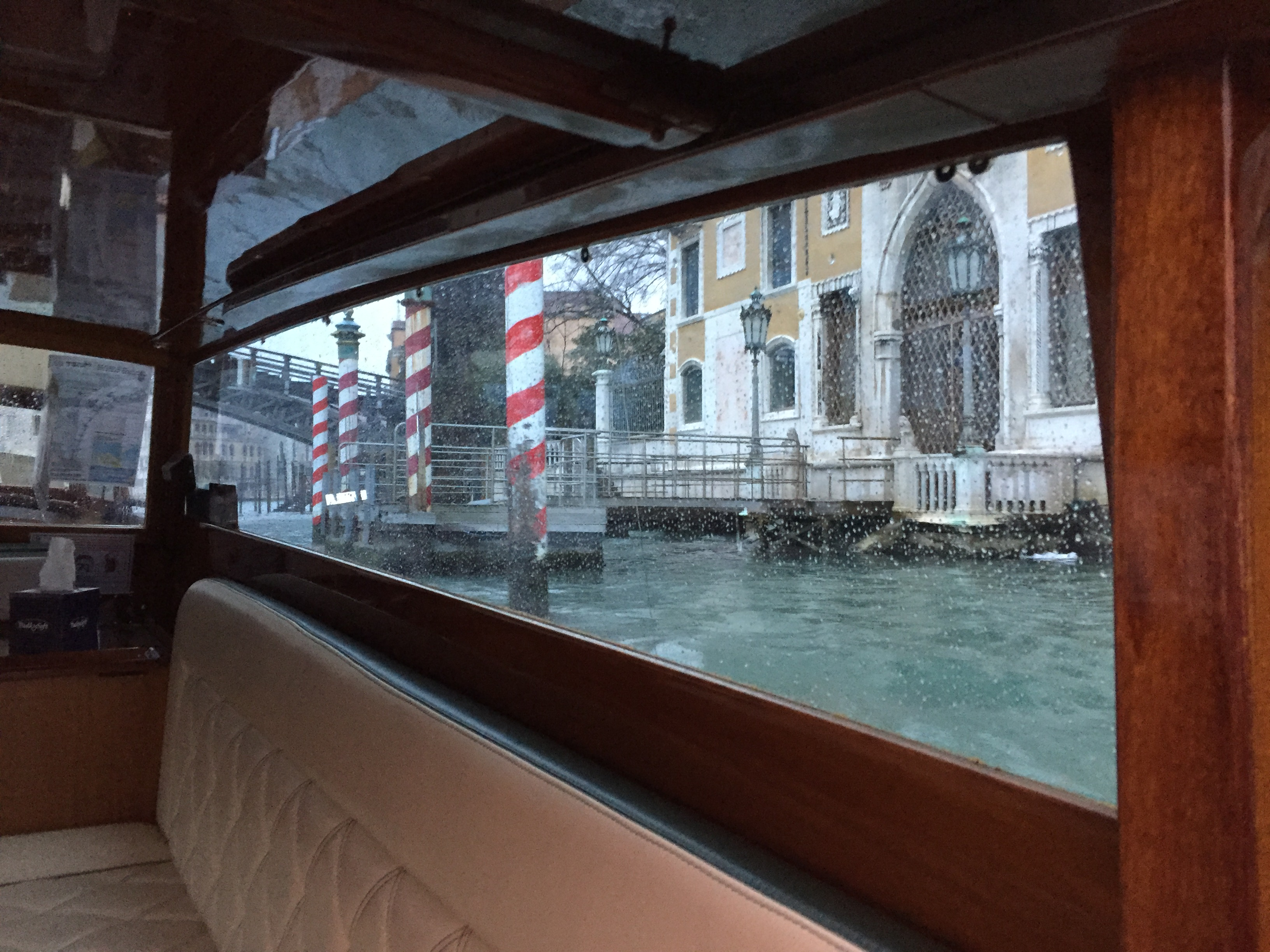 Finding rain in Venice? All the more reason to travel by boat taxi. Photo credit: Michael Ciavardini