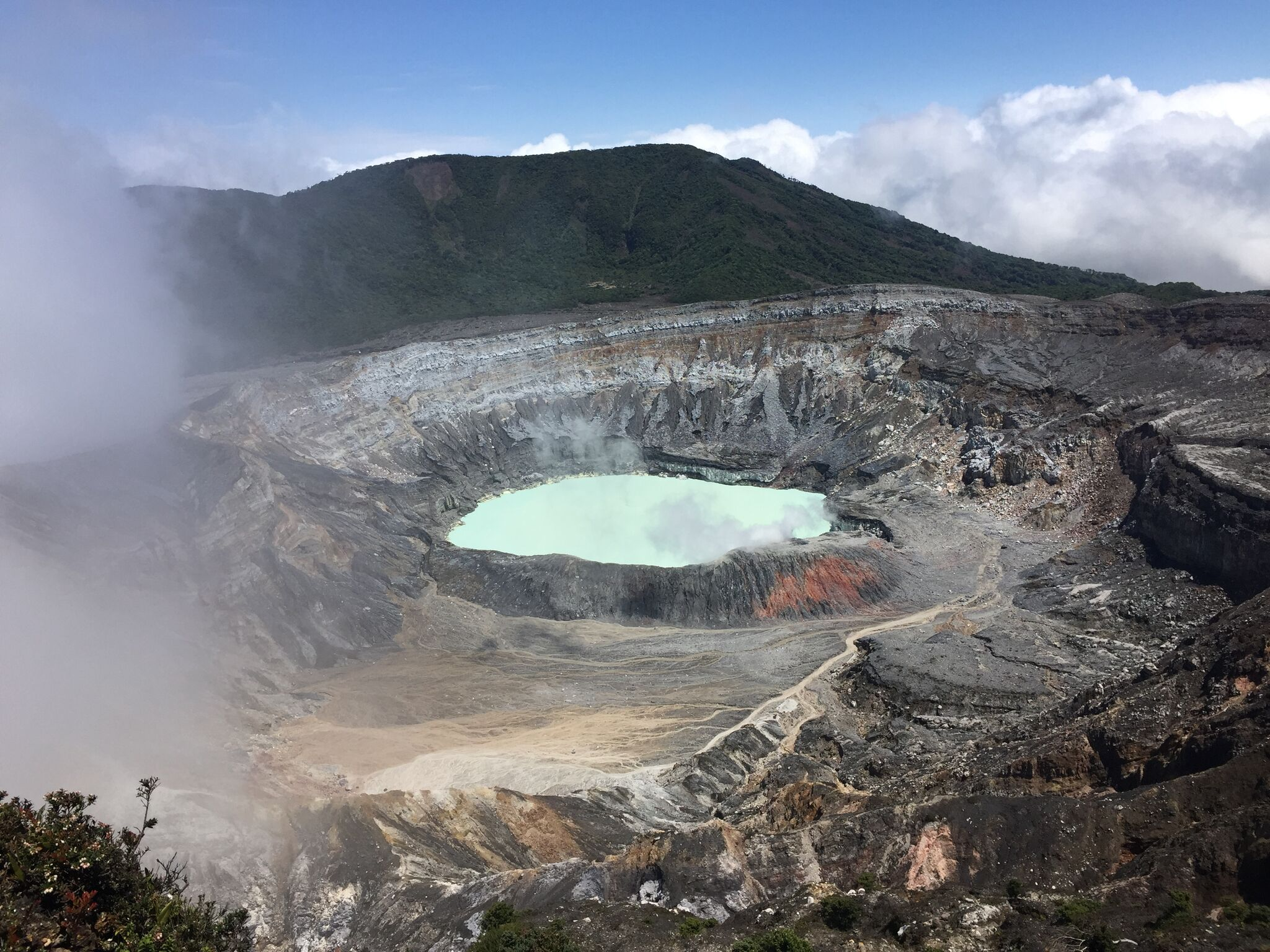 The blue-green hue at the edge of the Poas Volcano in Costa Rica. Photo credit: M. Ciavardini