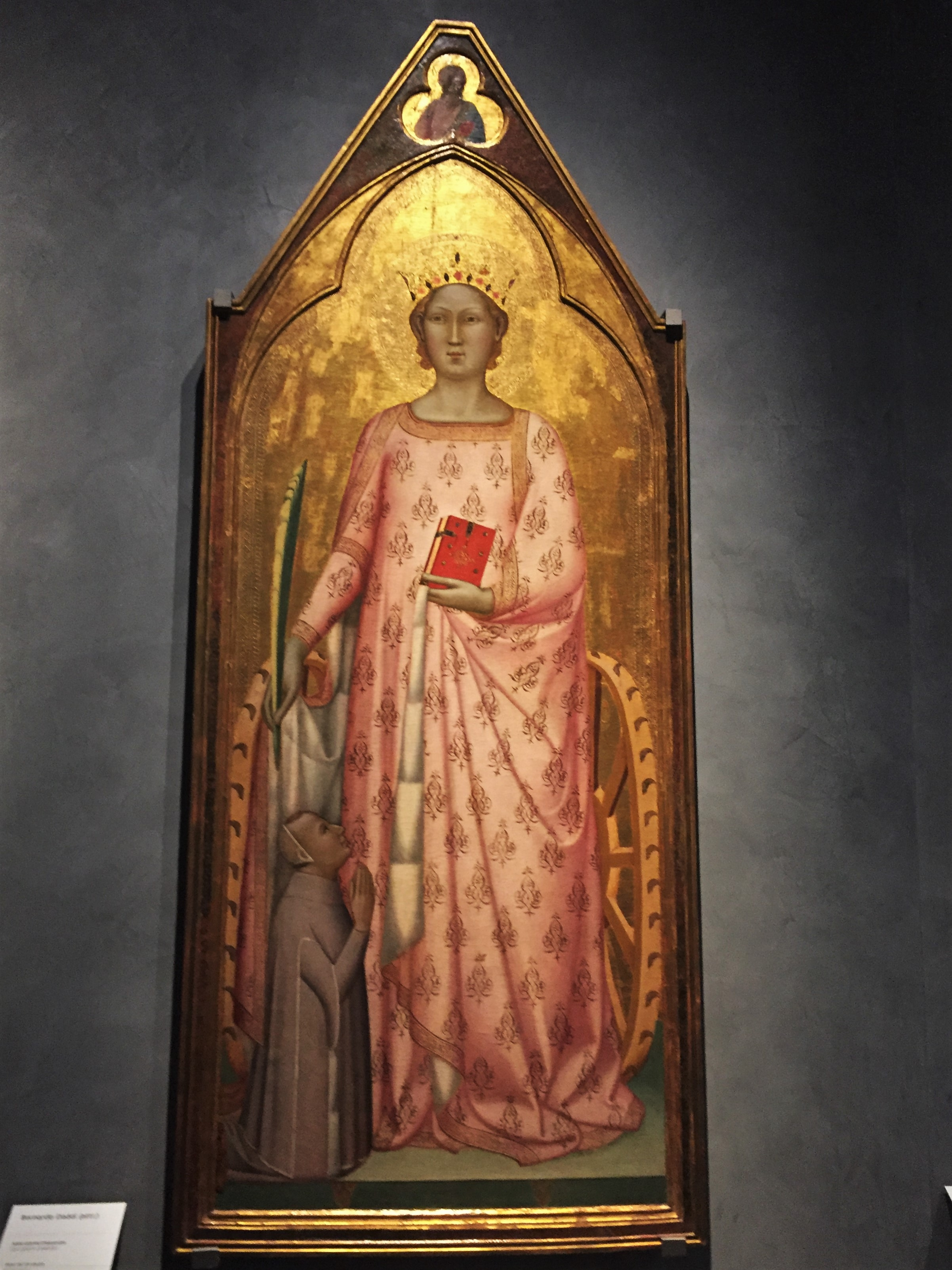 The woman in pink at the Opera Duomo Museum is Saint Catherine of Alexandria, a painting attributed to Bernardo Daddi. Photo credit: M. Ciavardini