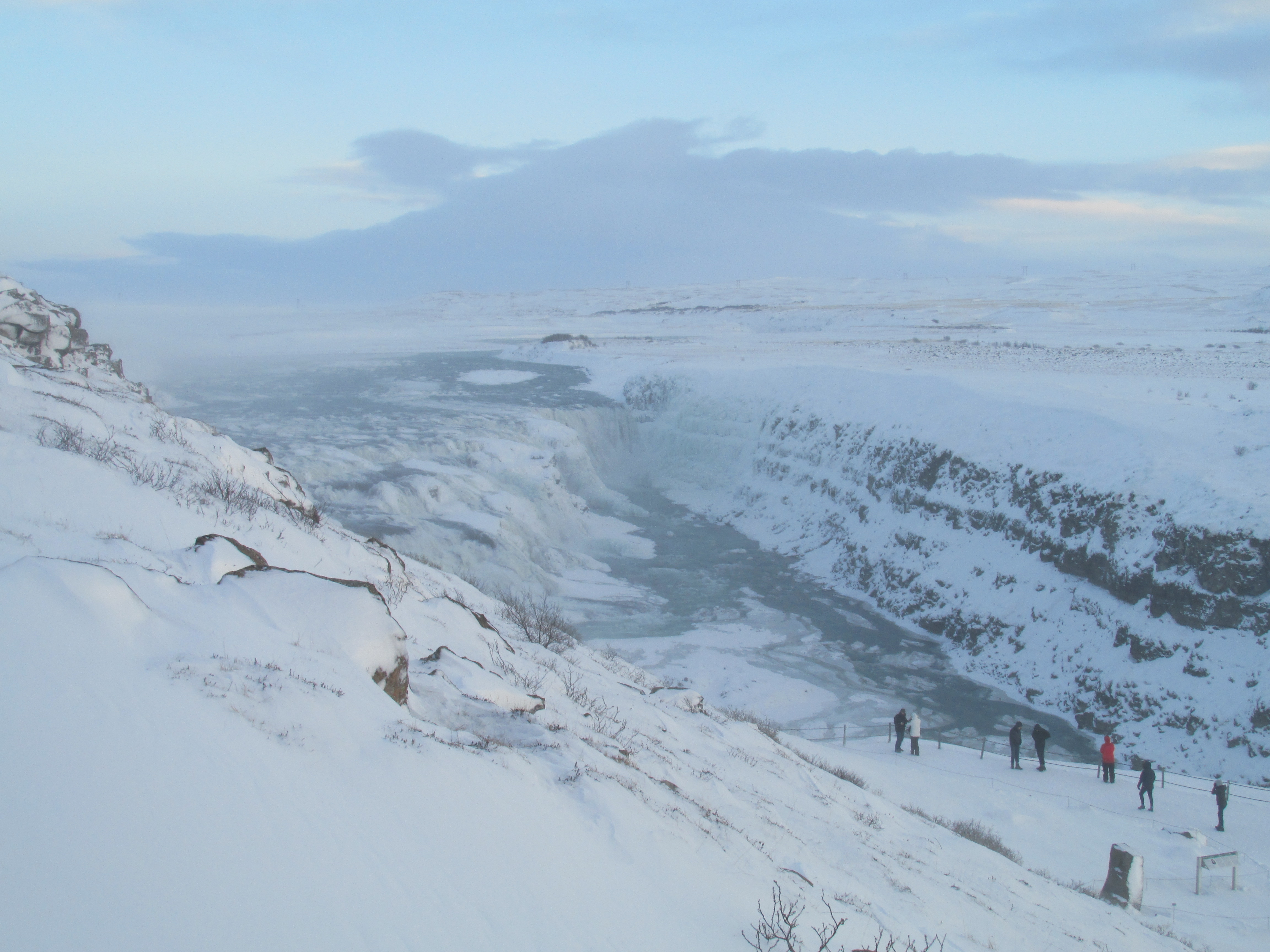 Don't let the weather deter you; dress appropriately when visiting Gullfoss waterfall in Iceland. Photo credit: M. Ciavardini
