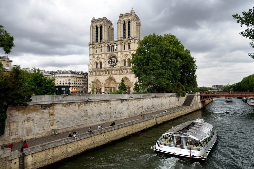 Traveling solo to Paris? Bring a sketch pad and draw Notre Dame Cathedral.