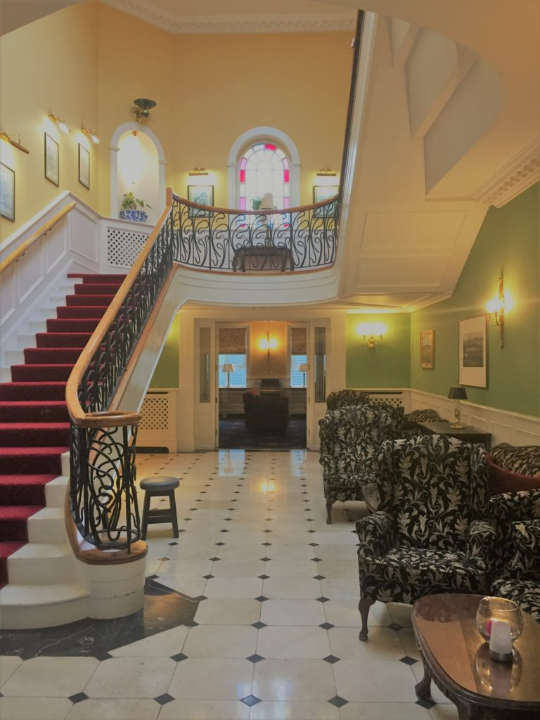 A grand sweeping staircase pretty much guarantees a traveler will enjoy her stay. Here, the lobby of the Dromhall Hotel in Killarney, County Kerry, Ireland. Photo credit: M. Ciavardini