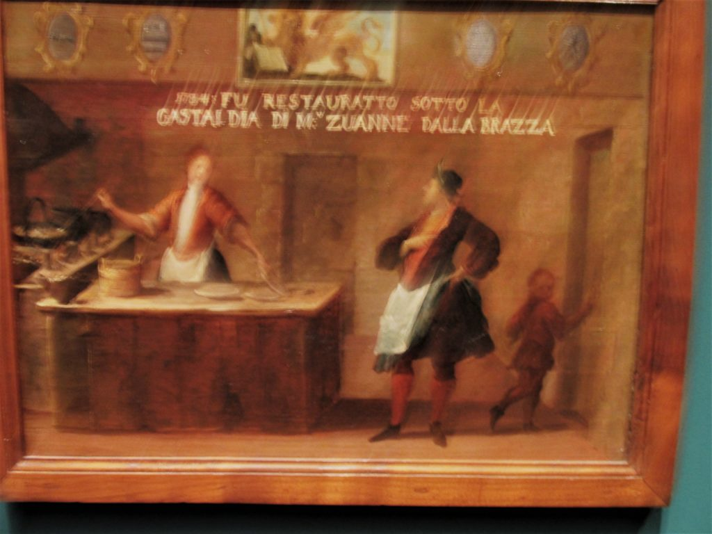 A somewhat blurry image of a Signboard of the Fritter Maker's Guild, or Insegna dell'Arte dei fritoleri, at the Doge Palace in Venice. Photo credit: M. Ciavardini