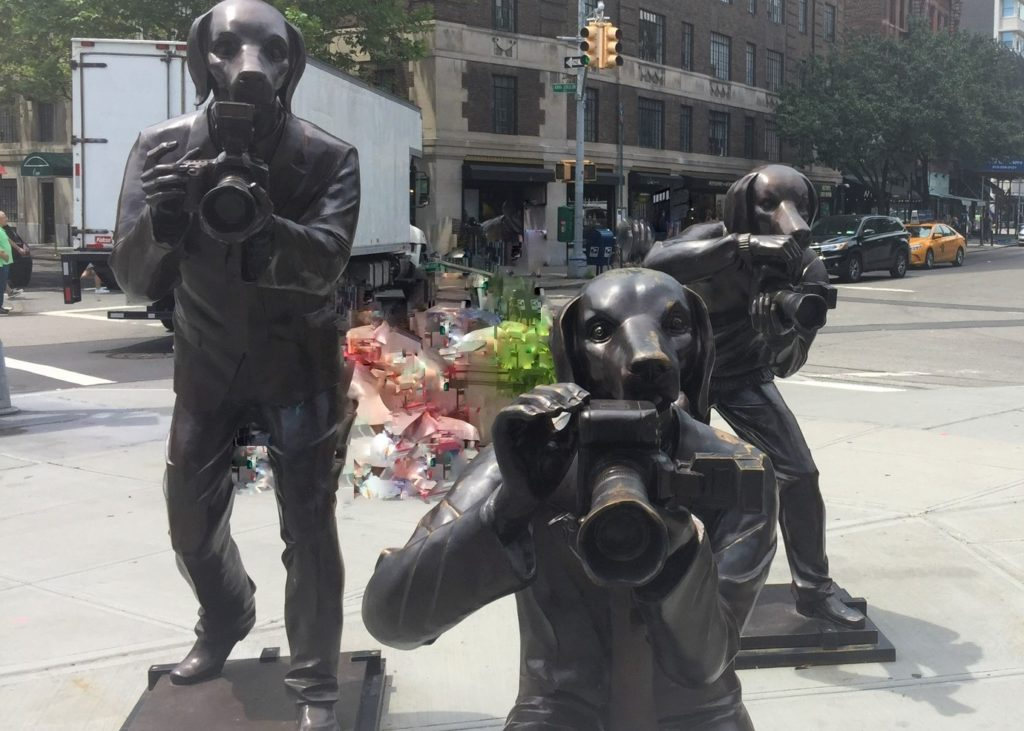 The dogged pursuit of a good picture in New York City. Paparazzi Dogs sculpture by the artists known as Gillie and Marc. Photo credit: M. Ciavardini