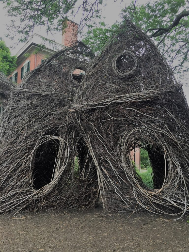 A nest suitable for a human on the Crowninshield-Bentley Lawn. Formally titled What the Birds Know, the work is by artist Patrick Dougherty. Photo credit: M. Ciavardini