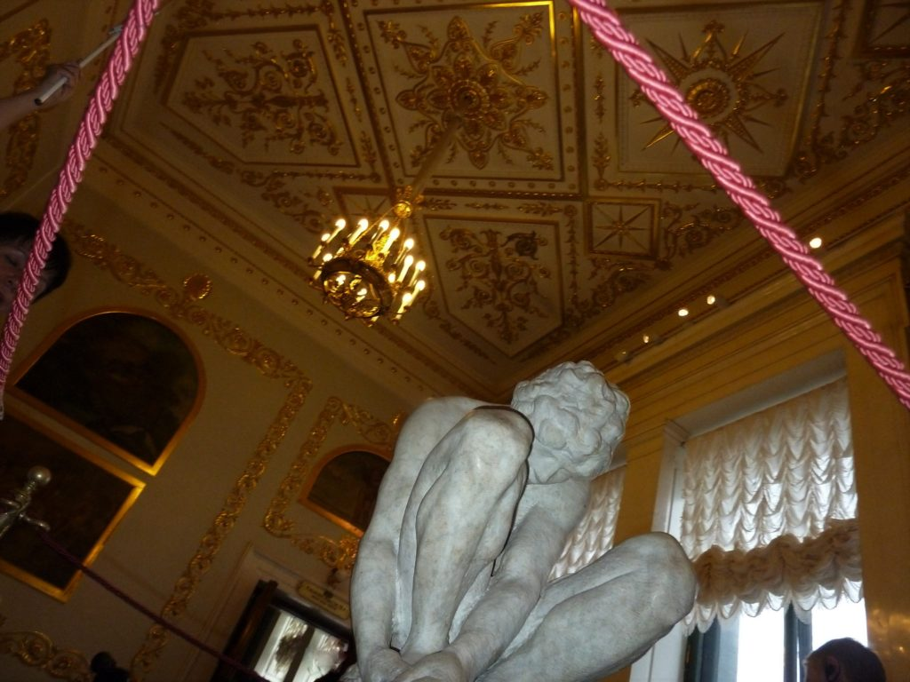 Barely more than an arm's length away, Michelangelo's Crouching Boy rests behind ropes in the Hermitage in St. Petersburg, Russia. Photo credit: M. Ciavardini.
