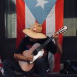 A busker in Old San Juan, Puerto Rico. Photo credit: M. Ciavardini.