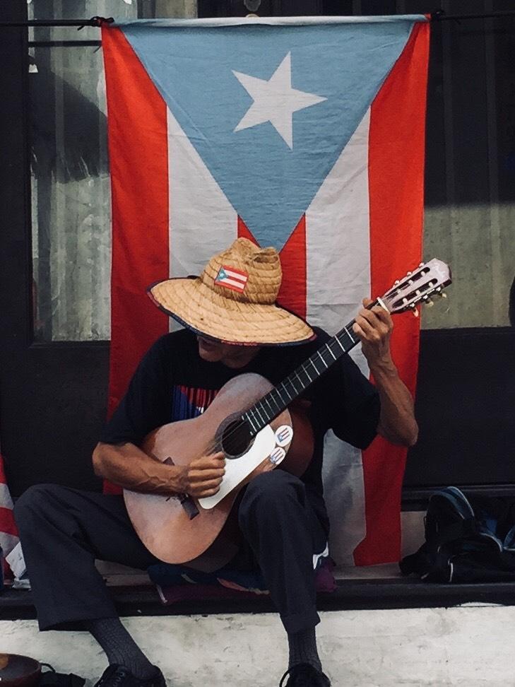 A busker in Old San Juan, Puerto Rico. Photo credit: M. Ciavardini.