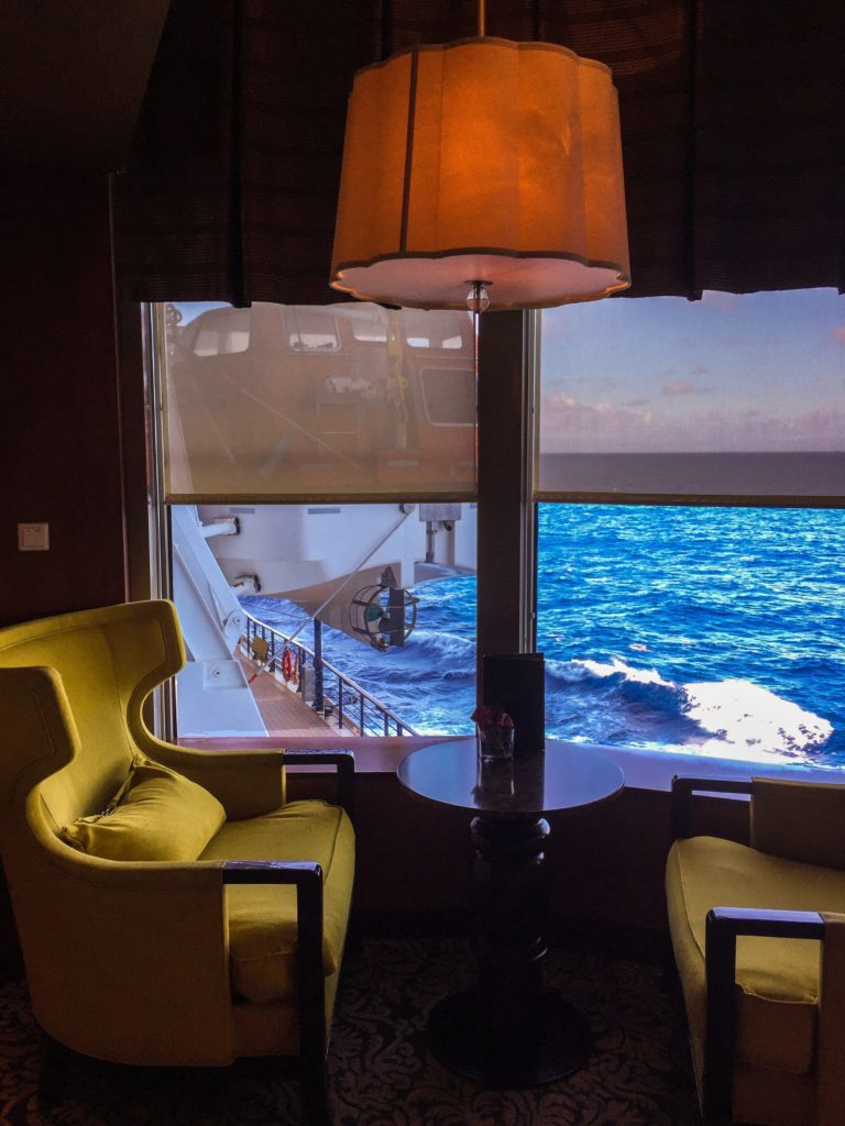 Enjoy a cappuccino and a book in the lounge at the Café Al Bacio on the Celebrity Summit. Photo credit: M. Ciavardini.